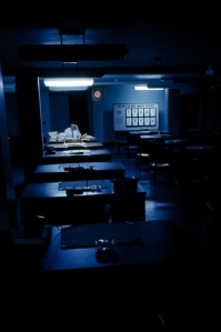 Alone in an office at night, an FBI agent sifts through files.